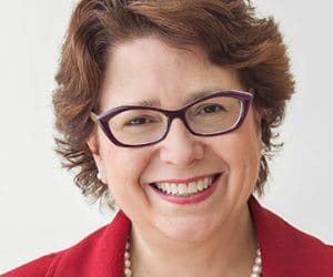Headshot of Sue Schade, a Principal at Starbridge Advisors, comments on the future of remote work in healthcare